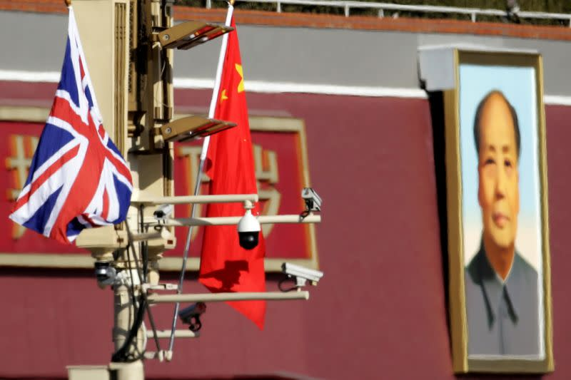 A Union flag and a Chinese flag are placed at a pole with security cameras in front of a portrait of late Chinese Chairman Mao Zedong at the Tiananmen gate during a visit by British Prime Minister Theresa May to China, in Beijing