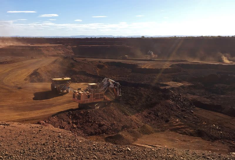 FILE PHOTO: An autonomous truck readies to pick up a load of iron ore at Australia's Fortescue Metals Group (FMG) Chichester Hub, which includes the Christmas Creek iron ore mine, in the Pilbara region