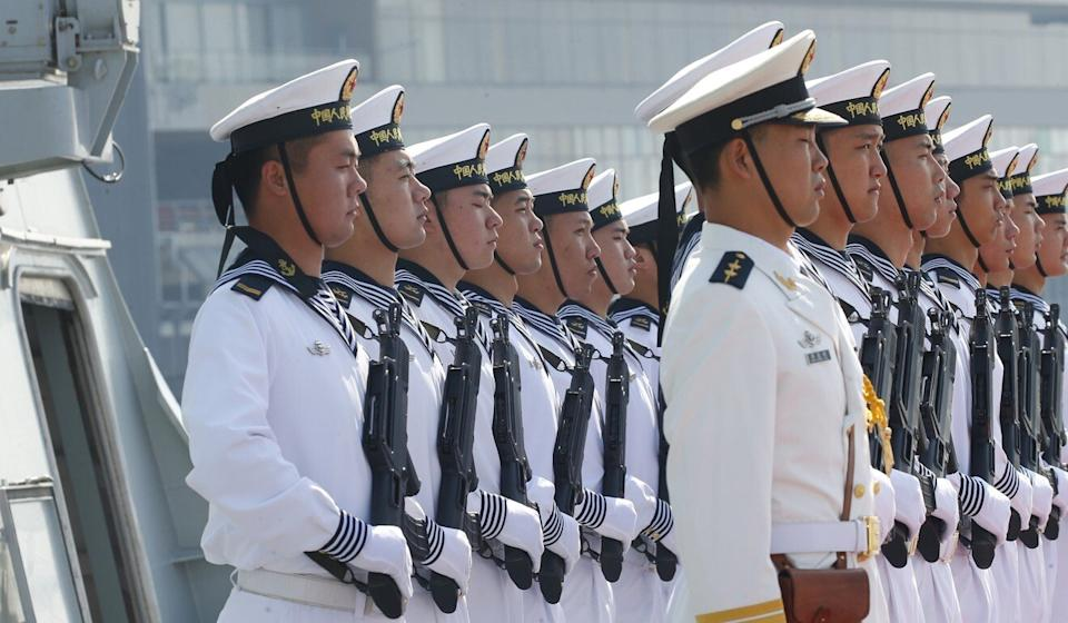 Chinese People's Liberation Navy sailors stand in formation on the deck of a frigate as it docks at Manila's South Harbor for a four-day port call in the Philippines in January 2019. Photo: AP