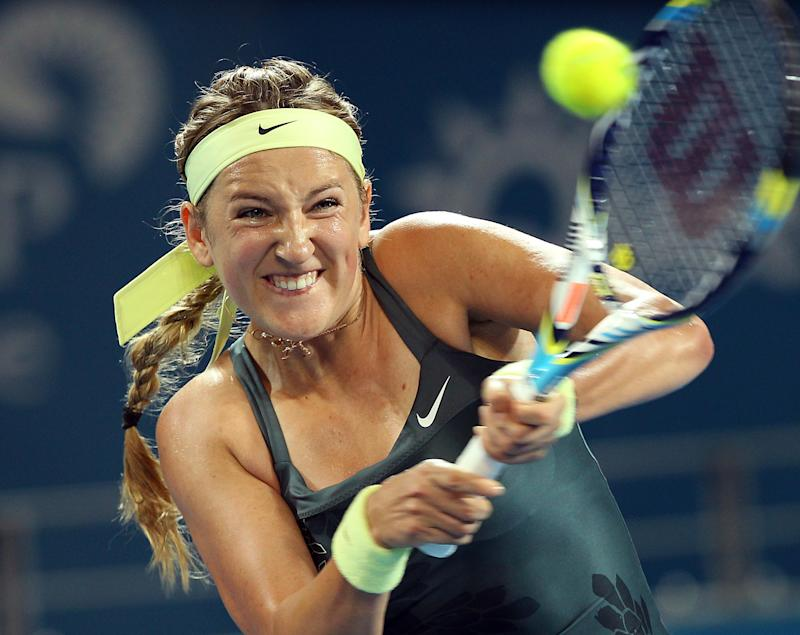 Victoria Azarenka of Belarus plays a shot in her second round match against Sabine Lisicki of Germany during the Brisbane International tennis tournament in Brisbane, Australia, Wednesday, Jan. 2, 2013.  (AP Photo/Tertius Pickard).