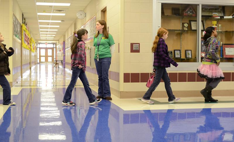 In this Feb. 22, 2013 photo provided by the Killeen Independent School District, students move through the halls of Meadows Elementary School in Fort Hood, Texas. Meadows is one of nine public schools on Fort Hood operated by Killeen Independent School District, which stands to lose at least $2.6 million before the end of the year if across-the-board federal spending cuts take effect. (AP Photo/Killeen Independent School District, Todd Martin)