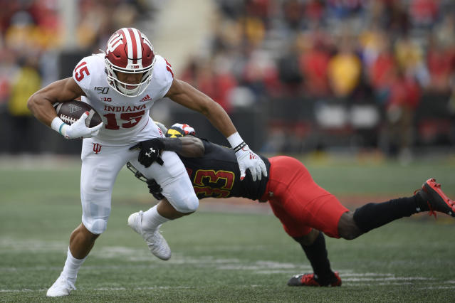 Indiana wide receiver Nick Westbrook (15) runs with the ball against Maryland defensive back Deonte Banks (33) during the first half of an NCAA football game, Saturday, Oct. 19, 2019, in College Park, Md. (AP Photo/Nick Wass)
