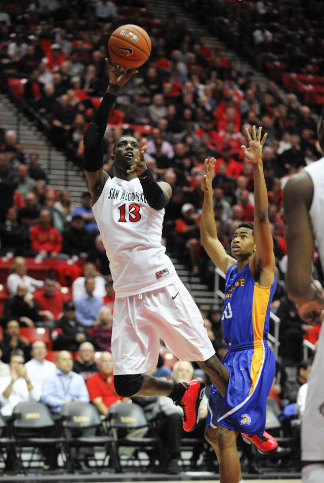San Diego State's Winston Shepard (13) shoots over San Jose State's Issac Thornton (20) during the first half of an NCAA college basketball game, Tuesday, Feb. 25, 2014, in San Diego. (AP Photo/Denis Poroy)