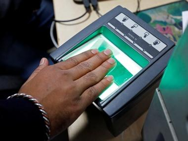A woman goes through the process of finger scanning for the Unique Identification (UID) database system, also known as Aadhaar. Image: Reuters