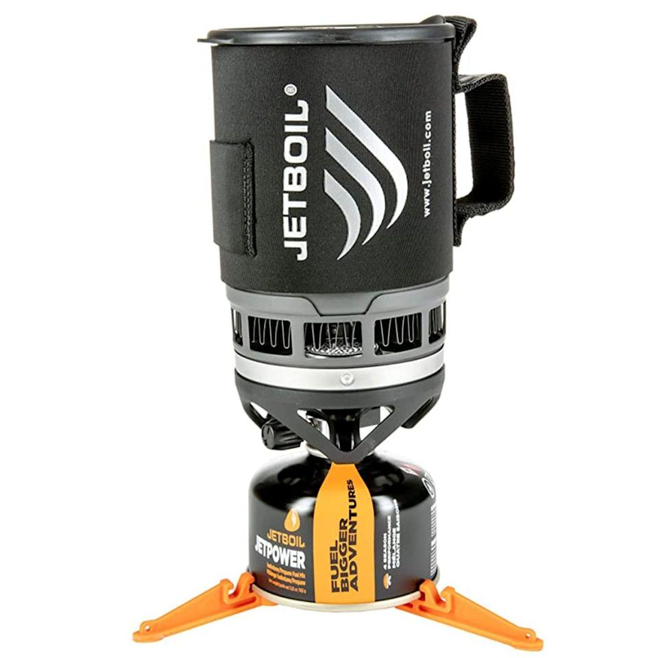 """<p><strong>Jetboil</strong></p><p>amazon.com</p><p><strong>$84.95</strong></p><p><a href=""""https://www.amazon.com/dp/B004UVPDUM?tag=syn-yahoo-20&ascsubtag=%5Bartid%7C2164.g.36556929%5Bsrc%7Cyahoo-us"""" rel=""""nofollow noopener"""" target=""""_blank"""" data-ylk=""""slk:Shop Now"""" class=""""link rapid-noclick-resp"""">Shop Now</a></p><p>This portable cooking system is ideal for the basics. The bottom cover even doubles as a measuring cup!</p>"""