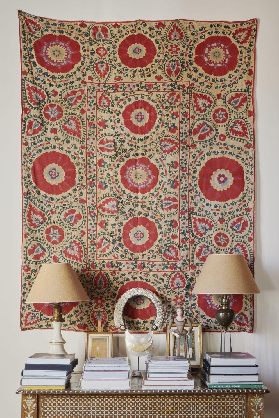 """<p>""""This is another Suzani from Central Asia and sits next to the living room entrance. They're hand-embroidered and serve the same purpose as a painting. They're decorative and beautiful.""""</p>"""