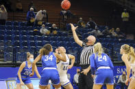 This photo provided by South Dakota State Athletics shows Creighton and South Dakota State women's college basketball players during a jump ball in an NCAA college basketball game in Brookings, South Dakota, Monday, Nov. 30, 3030. From left are Creighton's Carly Bachelor (22), Creighton's Mykel Parham (34) South Dakota State's Myah Selland (44) and Creighton's Chloe Dworak (34). It's a common sight to see players and coaches wear masks on the sideline so far this season during college basketball games to help prevent the spread of the coronavirus. The DePaul and Creighton women's basketball teams are among a few squads that have taken it a step further with their players wearing the masks while they are on the court playing.(Christian Gravius/South Dakota State Athletics via AP)