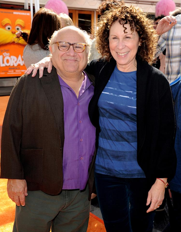 """UNIVERSAL CITY, CA - FEBRUARY 19:  Actors Danny DeVito (L) and Rhea Perlman arrive at the premiere of Universal Pictures and Illumination Entertainment's 3D-CG """"Dr. Seuss' The Lorax"""" at Citywalk on February 19, 2012 in Universal City, California.  (Photo by Kevin Winter/Getty Images)"""
