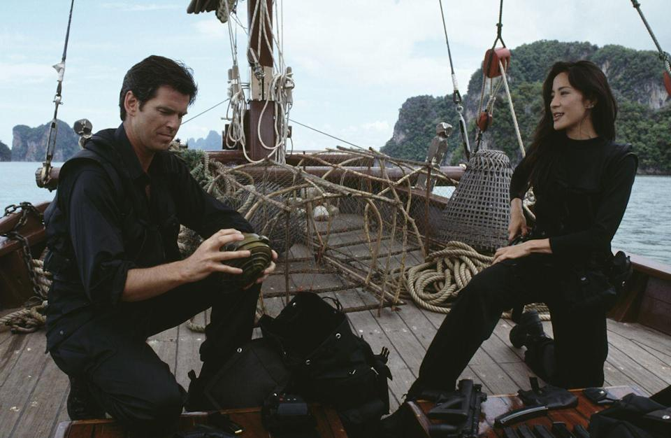 <p>Pierce Brosnan and Michelle Yeoh, on location in Thailand for 'Tomorrow Never Dies', 1997. </p>