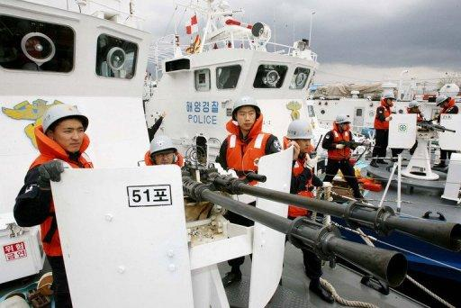 Members of South Korean Coast Guard participate in a drill at port Pohang, in 2006