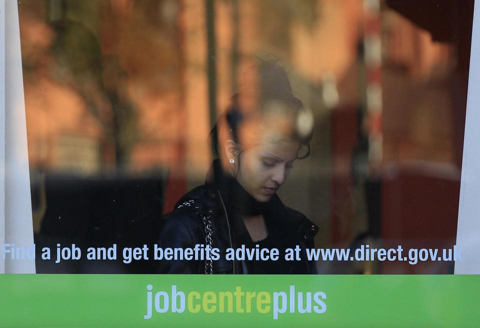 A woman enters an employment centre in Leicester, central England, October 20, 2010. Britain will take an axe to its welfare state on Wednesday as part of an 80 billion-pound ($125 billion) cut in public spending that will dictate the future of of both the economy and the coalition government.  REUTERS/Darren Staples   (BRITAIN - Tags: EMPLOYMENT BUSINESS POLITICS)