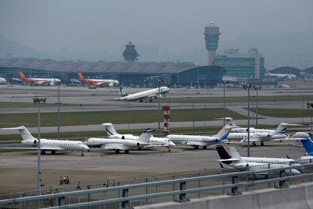 Business jets park at Hong Kong International Airport