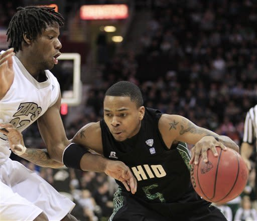 Ohio's D.J. Cooper (5) drives past Akron's Quincy Diggs (22) in the first half during an NCAA college basketball championship game in the Mid-American Conference men's tournament on Saturday, March 10, 2012, in Cleveland. (AP Photo/Tony Dejak)