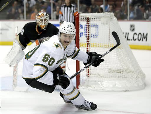 Dallas Stars' Antoine Roussel (60), of France, skates past Anaheim Ducks goalie Viktor Fasth, of Sweden, during the first period of an NHL hockey game in Anaheim, Calif., Wednesday, April 3, 2013. (AP Photo/Jae C. Hong)