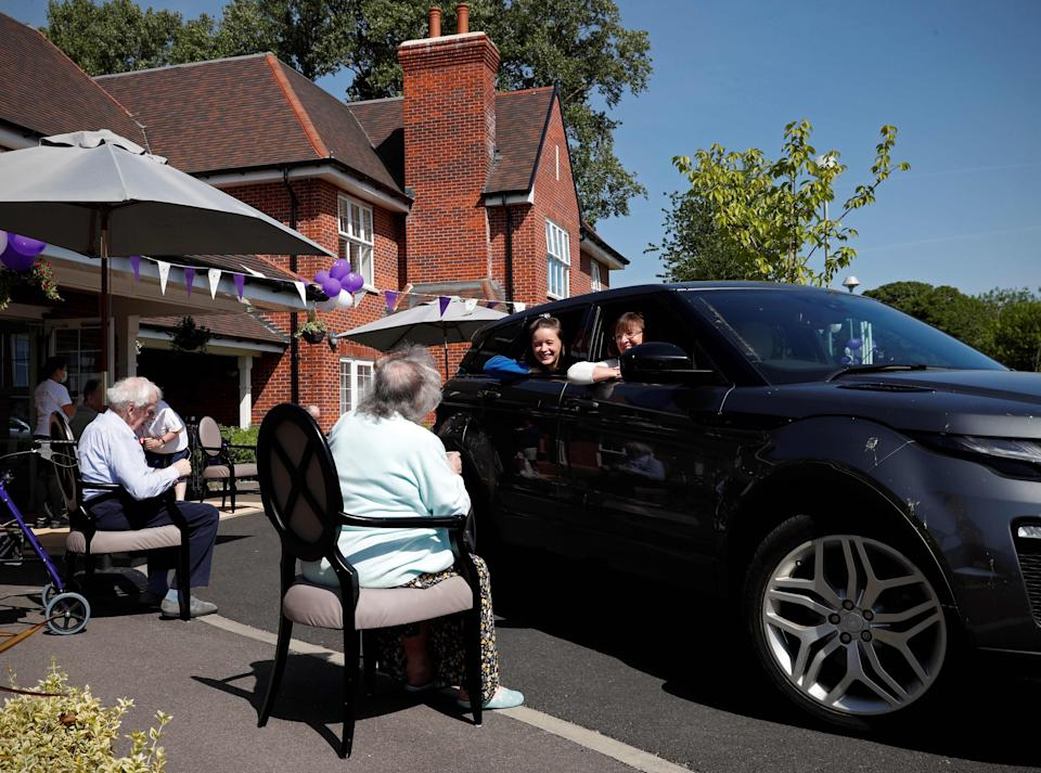 Socially distanced visit to care home (AFP/Getty)