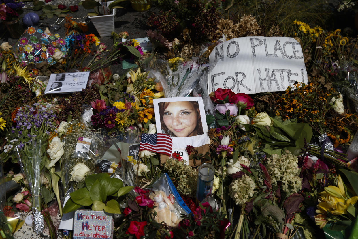 A photo of Heather Heyer, who was killed during a white nationalist rally, sits on the ground at a memorial the day her life was celebrated at the Paramount Theater, Wednesday, Aug. 16, 2017, in Charlottesville, Va. (Photo: Evan Vucci/AP)