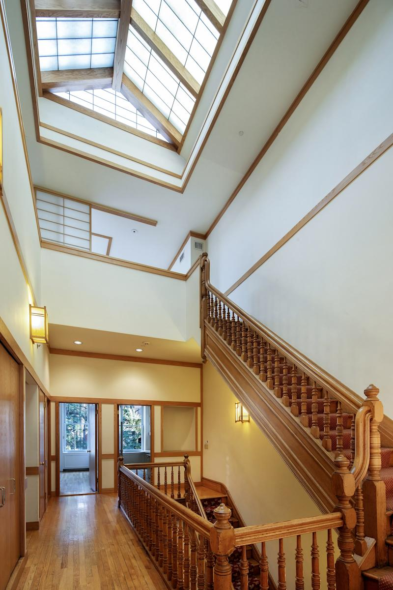 A skylight fills the stairwell with light.