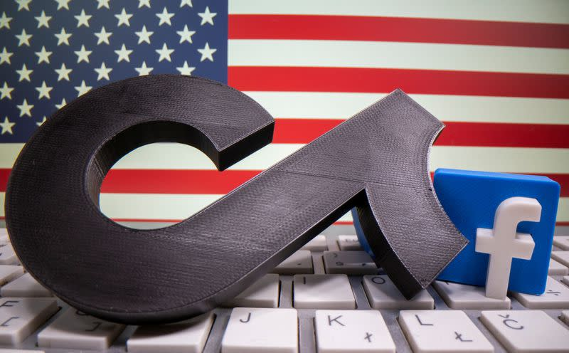 FILE PHOTO: A 3D printed Tik Tok and Facebook logo are placed on a keyboard in front of U.S. flag in this illustration