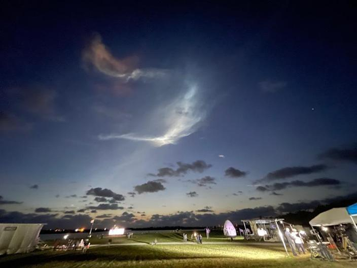 Exhaust clouds grace the dawn sky over the Kennedy Space Center press site after a SpaceX Falcon 9 rocket shot away to the northeast. / Credit: Steven Young/Spaceflight Now