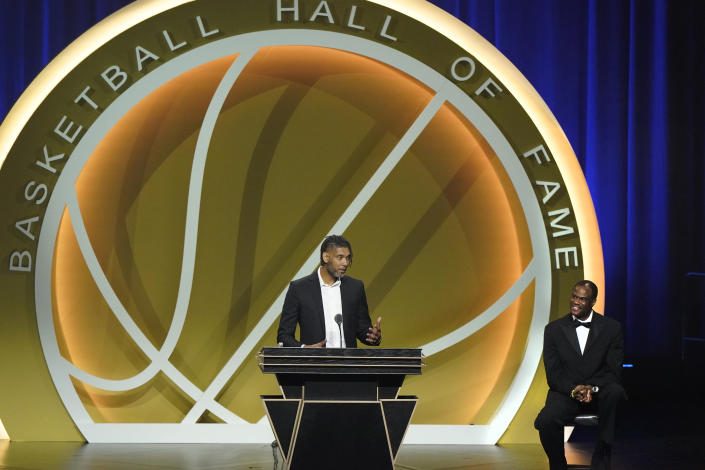 Tim Duncan speaks as presenter David Robinson, right, listens, as Duncan is enshrined with th 2020 Basketball Hall of Fame class Saturday, May 15, 2021, in Uncasville, Conn. (AP Photo/Kathy Willens)