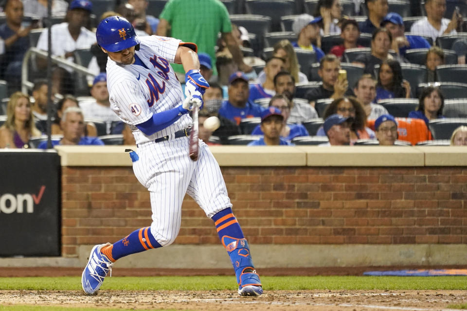 New York Mets' J.D. Davis hits a single during the fourth inning of the team's baseball game against the Toronto Blue Jays, Saturday, July 24, 2021, in New York. (AP Photo/Mary Altaffer)