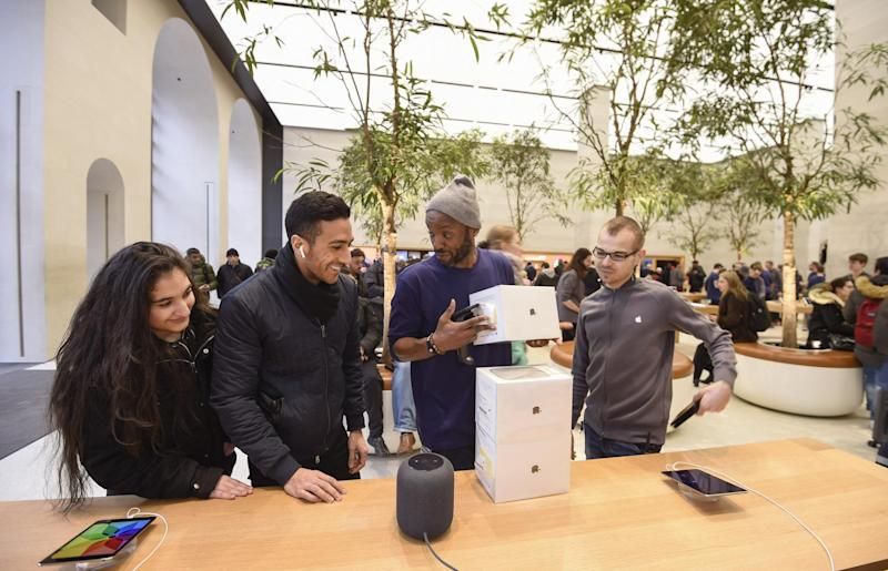 Customers look at The Apple HomePod, which is now available in stores in the US, UK and Australia, at Apple Store on Regent Street: Antony Jones/Getty Images for Apple
