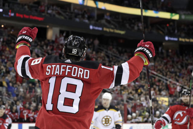 New Jersey Devils right wing Drew Stafford (18) raises his arms after scoring a goal against the Boston Bruins during the second period of an NHL hockey game Thursday, March 21, 2019, in Newark, N.J. (AP Photo/Julio Cortez)