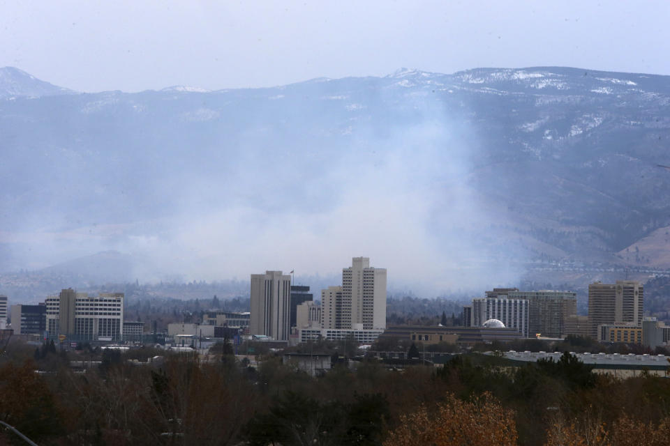 Wildfires in Southwest Reno, destroy a number of homes in the Juniper Hills area of Reno Nevada Tuesday, Nov.17, 2020, in Reno, Nev. (AP Photo/Lance Iversen)