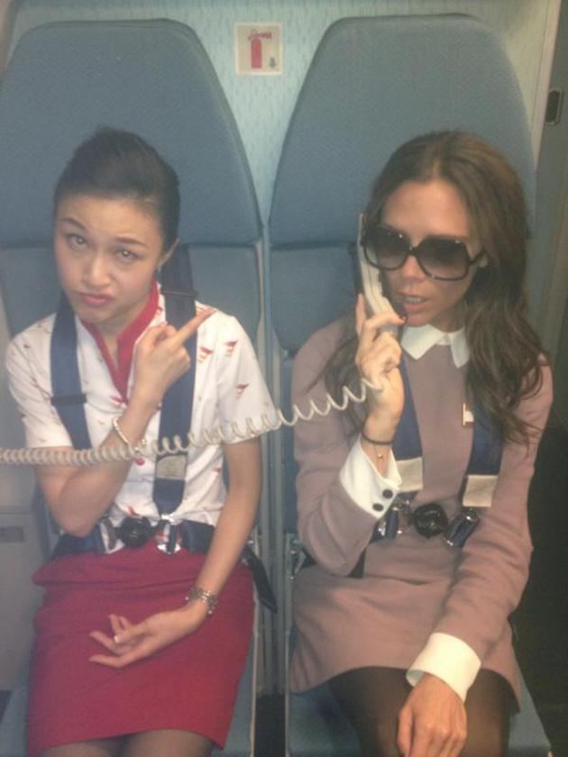 """Celebrity photos: Victoria Beckham showed her funny side this week, with this hilarious Twitpic. On a flight to Beijing, she decided to play air hostess, posing with the other cabin crew. She said: """"Cabin crew prepare for landing! Welcome to Beijing!!"""" She also explained this week that social networking has become very important to her: """"I try to give some personal insights to my followers as well as keeping them abreast of the business. I also think that my fans and customers really get to know me and my sense of humour through my tweets. I think people see the real me."""""""