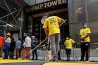 """People paint """"Black Lives Matter"""" along 5th avenue outside Trump Tower in New York City"""