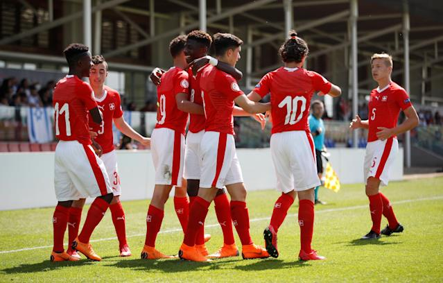 Soccer Football - UEFA European Under-17 Championship - Group A - Switzerland v Israel - St George's Park Stadium, Burton Upon Trent, Britain - May 7, 2018 Switzerland's Tician Tushi celebrates with team mates after scoring their third goal Action Images via Reuters/Carl Recine