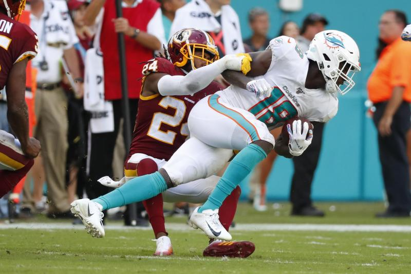 Washington Redskins cornerback Josh Norman (24) pulls down Miami Dolphins wide receiver Preston Williams (18), during the second half at an NFL football game, Sunday, Oct. 13, 2019, in Miami Gardens, Fla. (AP Photo/Wilfredo Lee)