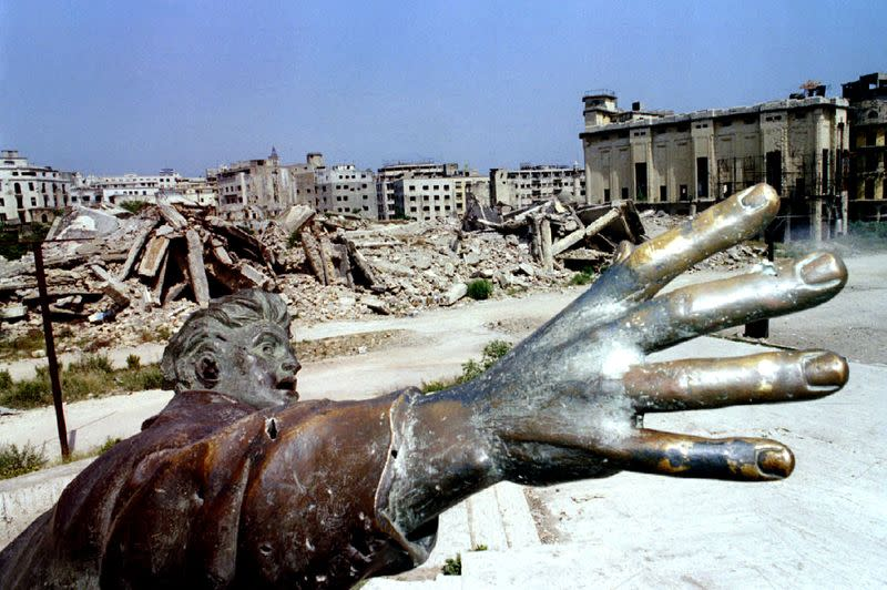 FILE PHOTO: OCTOBER 1993- Beirut's martyrs square statue on the former green line.