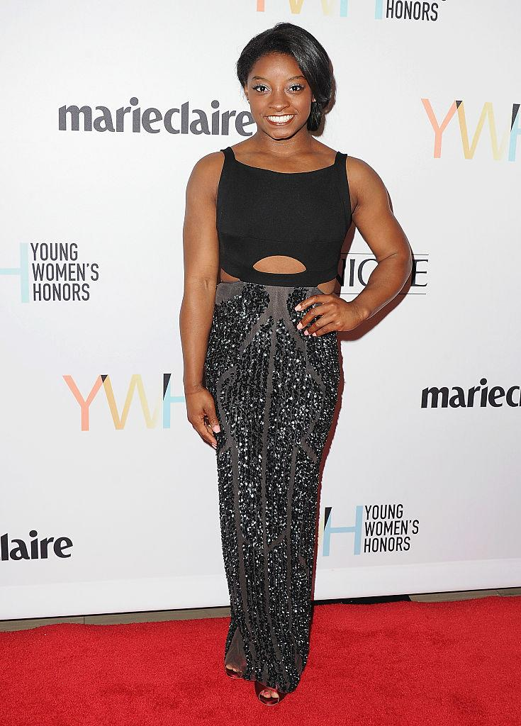 Simone Biles with the friendly reminder that she thinks her body is amazing, no matter what internet trolls may say. (Photo: Getty Images)