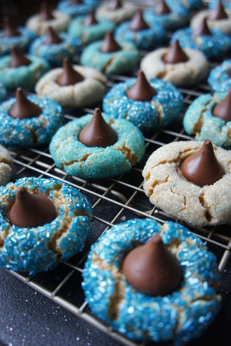 "<p>A classic peanut butter kiss cookie recipe gets dressed up for Hanukkah in this colorful version. Instead of rolling the dough in regular sugar, roll in a variety of sparkly blue sprinkles and sugars for an eye-catching holiday twist.</p><p><em><a href=""http://www.kveller.com/recipe-hanukkah-peanut-butter-kiss-cookies/"" rel=""nofollow noopener"" target=""_blank"" data-ylk=""slk:Get the recipe for Hanukkah peanut butter kiss cookies"" class=""link rapid-noclick-resp"">Get the recipe for Hanukkah peanut butter kiss cookies</a></em></p>"