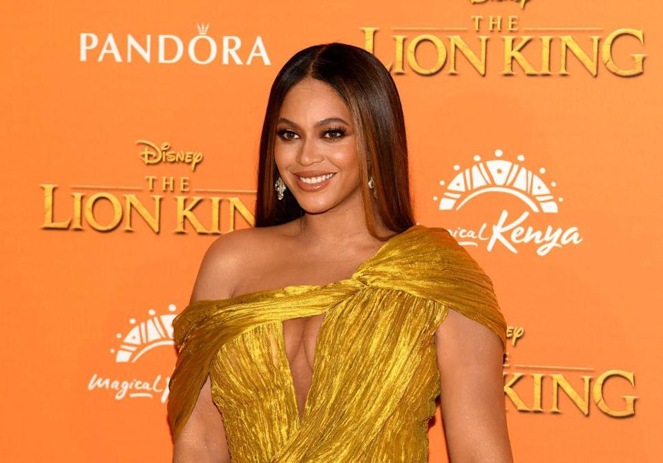Beyonce in a gold dress at lion kind premiere