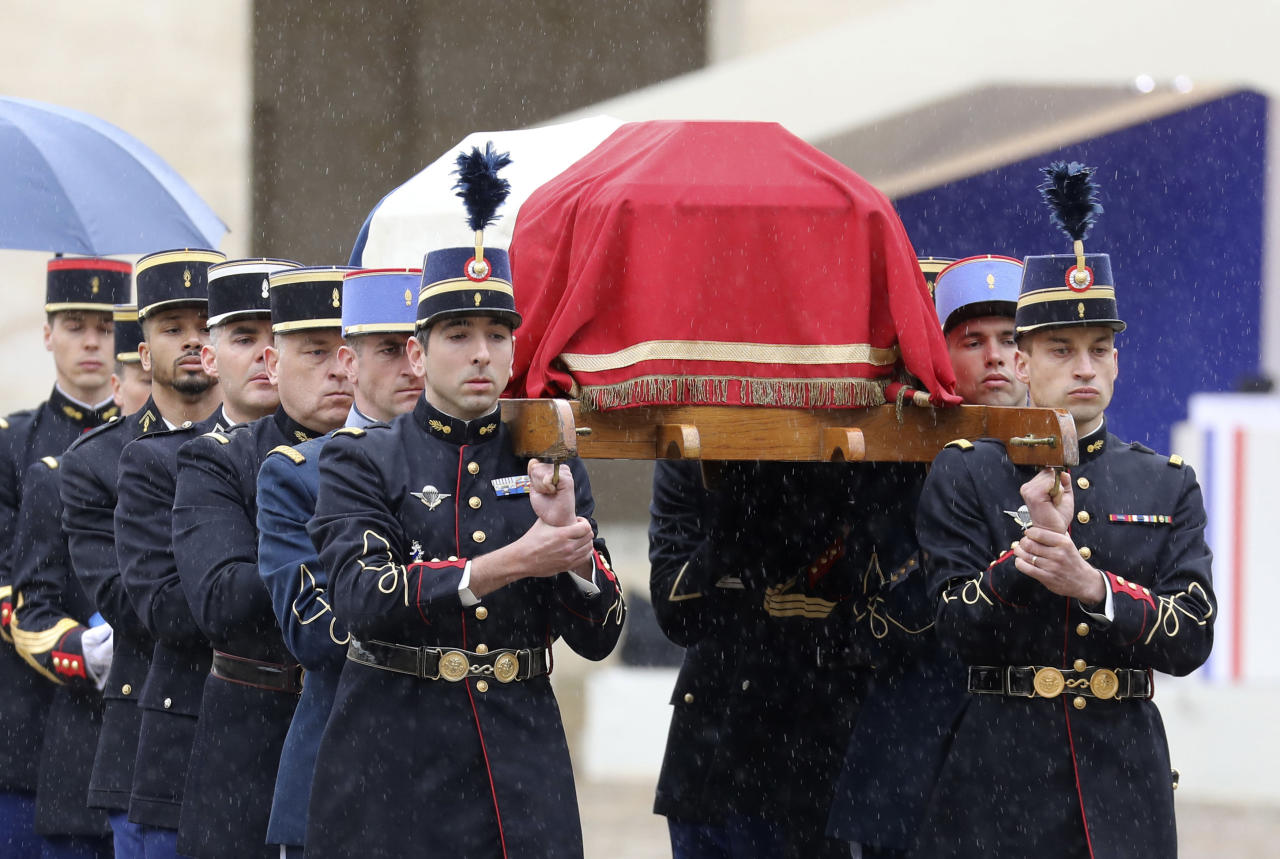 <p>The coffin of Lieutenant Colonel Arnaud Beltrame was carried in procession in the Wednesday morning drizzle from the Pantheon across Paris to the Hotel des Invalides, the final resting place of Napoleon. (PA) </p>