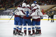 Colorado Avalanche celebrate after left wing J.T. Compher (37) scored against the Vegas Golden Knights during the third period of an NHL hockey game Monday, May 10, 2021, in Las Vegas. (AP Photo/John Locher)