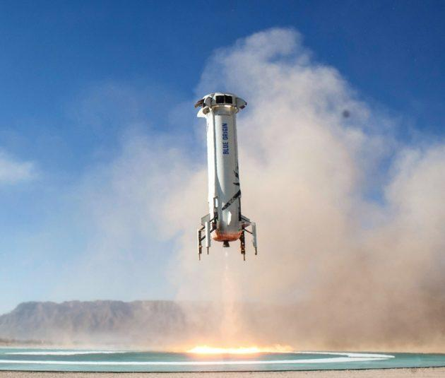 Blue Origin's New Shepard booster heads for a touchdown after a test flight in December. (Blue Origin Photo)