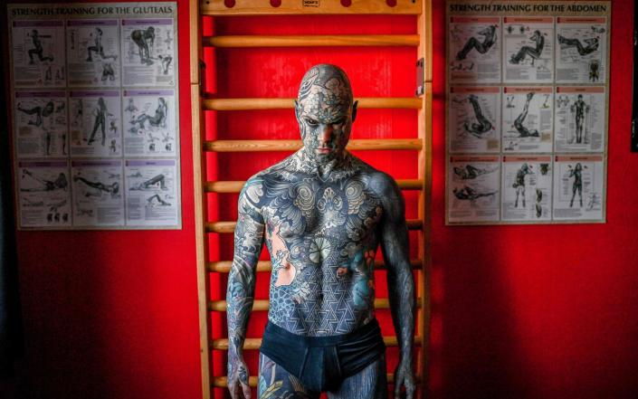 Mr Helaine says that getting tattoos is his passion - CHRISTOPHE ARCHAMBAULT/AFP