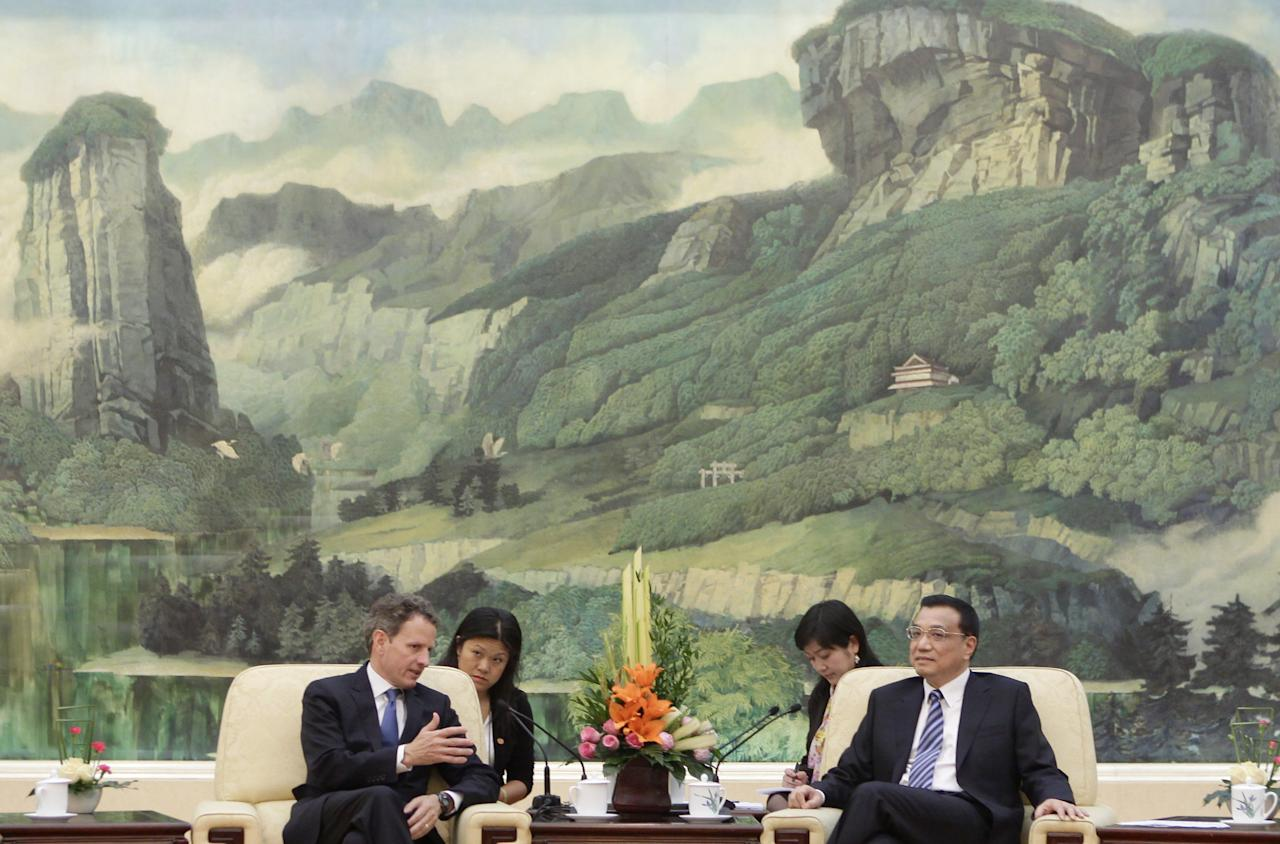BEIJING, CHINA - MAY 3: U.S. Treasury Secretary Timothy Geithner (L) talks with China's Vice Premier Li Keqiang (R) during a meeting at the Great Hall of the People on May 4, 2012 in Beijing. Hillary Clinton is in China for bilateral talks and has called on China to protect human rights. (Photo by Jason Lee/Pool/Getty Images)