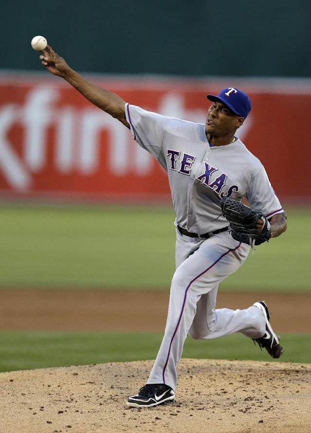 Texas Rangers' Alexi Ogando works against the Oakland Athletics in the first inning of a baseball game Friday, Aug. 2, 2013, in Oakland, Calif. (AP Photo/Ben Margot)