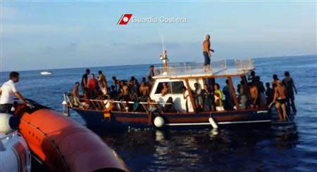 A still image taken from video released by the Italian Coastguard shows migrants rescued from the water off the southern Italian island of Lampedusa