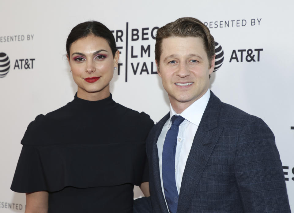 "Actors Morena Baccarin, left, and husband Benjamin McKenzie attend the screening for ""Framing John DeLorean"" during the 2019 Tribeca Film Festival at the SVA Theatre on Tuesday, April 30, 2019, in New York. (Photo by Brent N. Clarke/Invision/AP)"