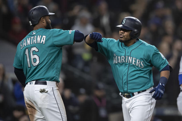 Seattle Mariners' Edwin Encarnacion, right, is congratulated by Domingo Santana after hitting a three-run home run off of Texas Rangers starting pitcher Shelby Miller that also scored Santana and Daniel Vogelbach during the third inning of a baseball game, Friday, April 26, 2019, in Seattle. (AP Photo/Stephen Brashear)