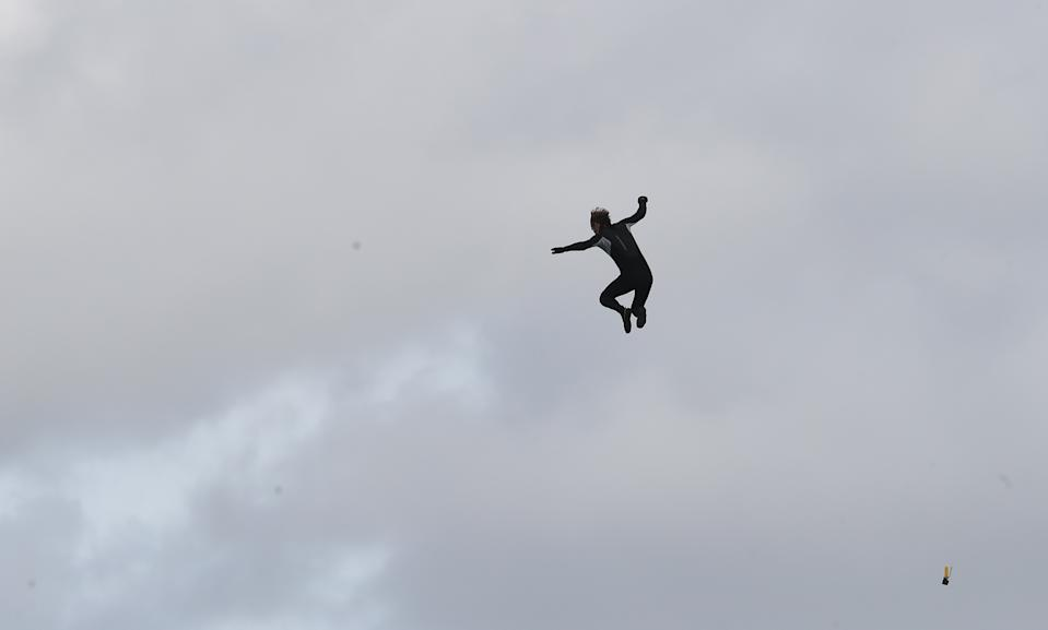 Former paratrooper John Bream jumps from a helicopter as he attempts to set the record for highest jump without a parachute by jumping 40m from a helicopter off Hayling Island in Hampshire. (Photo by Andrew Matthews/PA Images via Getty Images)