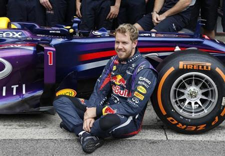 Sebastian Vettel of Germany is pictured as he poses for the media with the Red Bull team before the Brazilian F1 Grand Prix at the Interlagos circuit in Sao Paulo