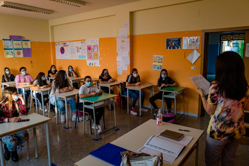 Students inside the classroom, begin their first lesson on the first day of school in the high school Mons. Antonio Bello in Molfetta, on 21 September in Molfetta. First day of school in many institutions that are not polling stations. In Puglia the departure is set for next Thursday, September 24th. But several schools have decided to anticipate in order to take advantage of a few more days of rest during the year. Admissions were staggered, contingent attendance and all students wore masks at the entrance before lessons. (Photo by Davide Pischettola/NurPhoto via Getty Images)