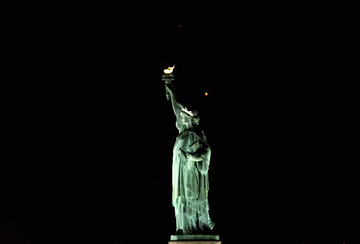 Saturn and Jupiter set behind the Statue of Liberty ahead of their conjunction, on December 17, 2020, in New York City. / Credit: Gary Hershorn / Getty Images