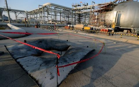 <span>A metal part of a damaged tank at the damaged site of Saudi Aramco oil facility in Abqaiq</span> <span>Credit: REUTERS/Hamad l Mohammed </span>